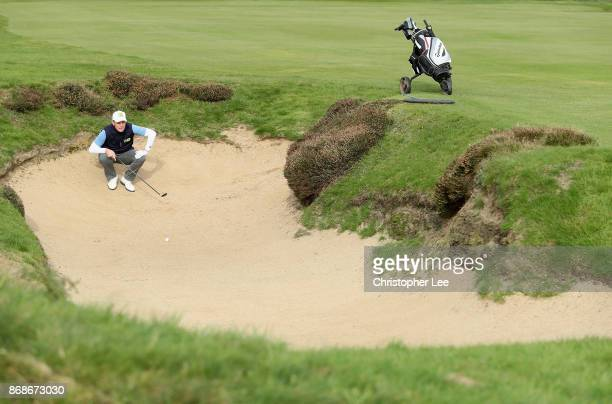 David Higgins of Waterville Golf Club plays a shot out the fairway bunker during Day 2 of the PGA PlayOffs at Walton Heath Golf Club on October 31...