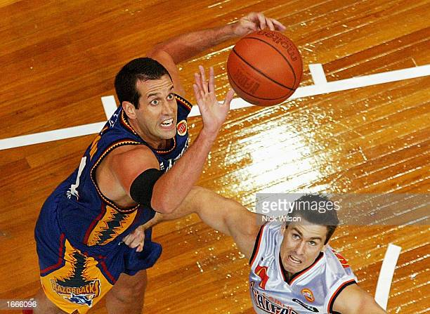David Hinton of the Razorbacks grabs the rebound from Ben Arkell of the Taipans during the NBL match between the West Sydney Razorbacks and the...