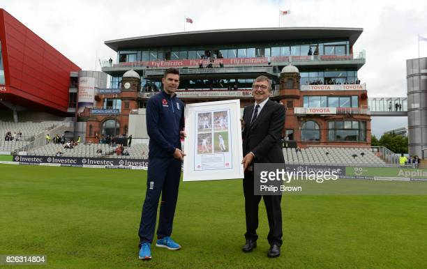 David Hodgkiss chairman of Lancashire CCC presents James Anderson with a framed photograph after the naming of the James Anderson end before the...