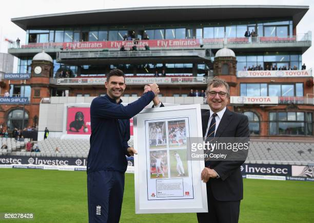 David Hodgkiss Chairman of Lancashire CCC presents James Anderson of England with a framed photo after the naming of the James Anderson End during...