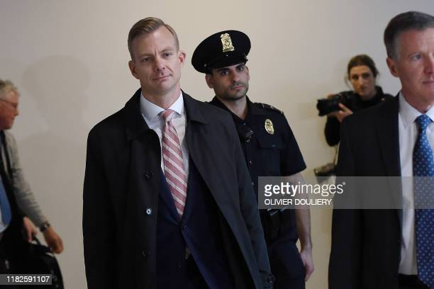 David Holmes a State Department official arrives to appear in a closeddoor deposition hearing as part of the impeachment inquiry at the US Capitol in...