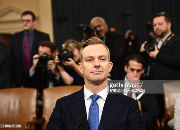 David Holmes a State Department official stationed at the US Embassy in Ukraine arrives to testify during the House Intelligence Committee hearing as...