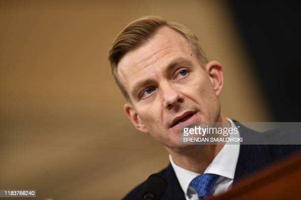 David Holmes a State Department official stationed at the US Embassy in Ukraine testifies during the House Intelligence Committee hearing as part of...