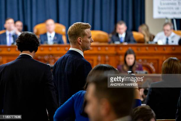 David Holmes a State Department official stationed at the US Embassy in Ukraine leaves during a break during the House Intelligence Committee hearing...