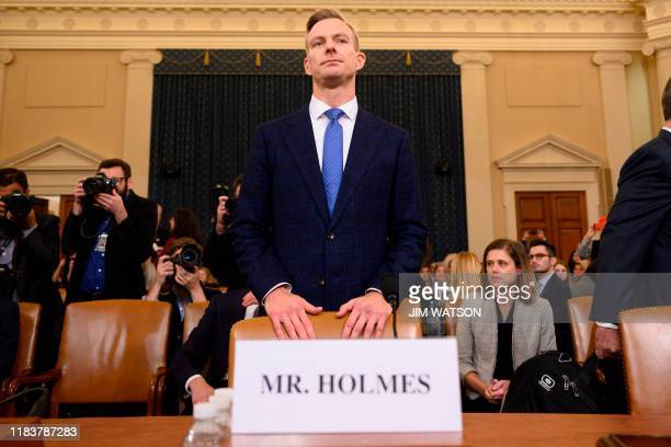 David Holmes a State Department official stationed at the US Embassy in Ukraine returns from a break to testify during the House Intelligence...