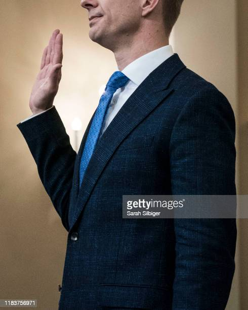 David Holmes an official from the American embassy in Ukraine is sworn in before testifying to the House Intelligence Committee in the Longworth...