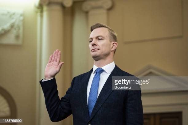 David Holmes counselor for political affairs at the US Embassy in Ukraine swears in to a House Intelligence Committee impeachment inquiry hearing in...