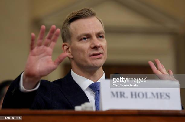 David Holmes the under secretary of state for political affairs testifies before the House Intelligence Committee in the Longworth House Office...