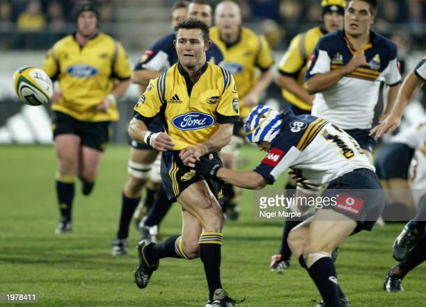 David Holwell of the Hurricanes gets a pass away during the Super 12 match between the Hurricanes and the ACT Brumbies May 3 2003 held at Westpac...