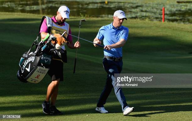 David Horsey of England and his caddie on the par four 17th hole during the first round of the Maybank Championship Malaysia at Saujana Golf and...