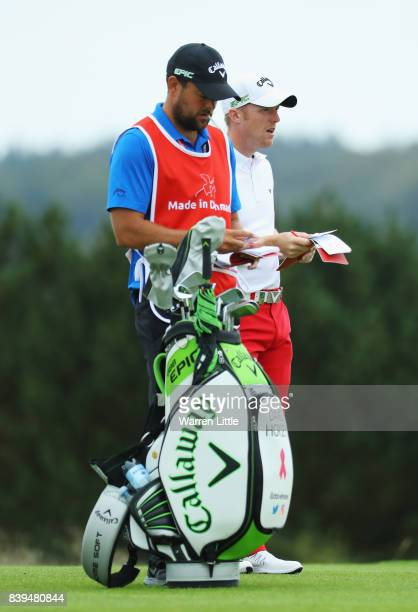 David Horsey of England checks the yardage with his caddie on the 13th hole during day three of the Made in Denmark at Himmerland Golf Spa Resort on...