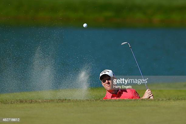 David Horsey of England chips out of a bunker at the eighteenth on day three of the M2M Russian Open at Tseleevo Golf Polo Club on July 26 2014 in...