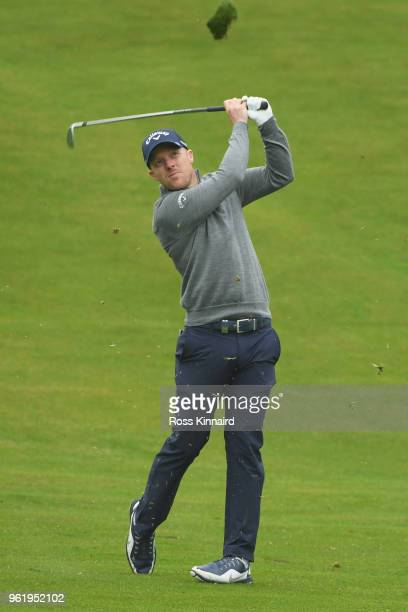 David Horsey of England hits his second shot on the 7th hole with his caddie during the first round of the BMW PGA Championship at Wentworth on May...