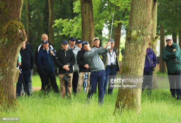 David Horsey of England plays his second shot on the 16th hole from the tree during day one of the BMW PGA Championship at Wentworth on May 24 2018...