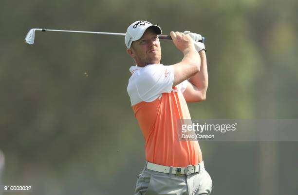 David Horsey of England plays his second shot on the par 5 18th hole during the first round of the Omega Dubai Desert Classic on the Majlis Course at...