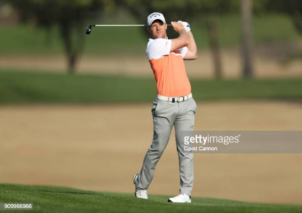 David Horsey of England plays his second shot on the par 5 third hole during the first round of the Omega Dubai Desert Classic on the Majlis Course...