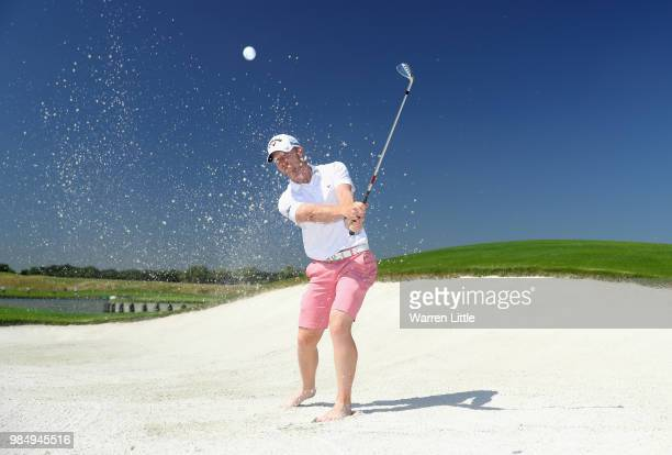 David Horsey of England poses for a picture on the 18th green ahead of the HNA Open de France at Le Golf National on June 27 2018 in Paris France