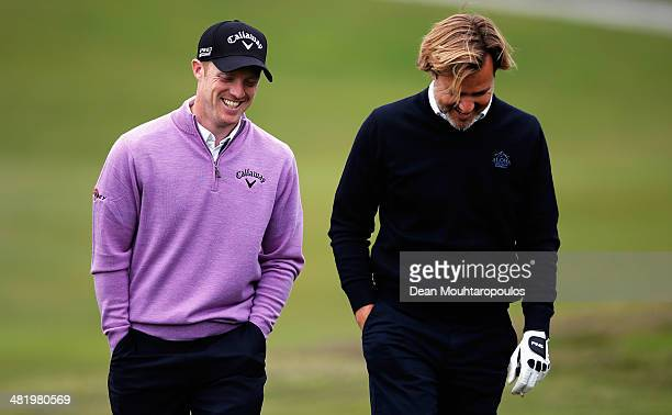 David Horsey of England shares a joke with another player on the 9th hole during the ProAm for the NH Collection Open held at La Reserva de...
