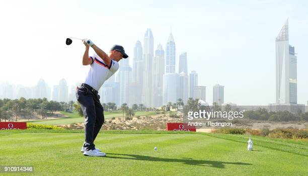 David Horsey of England tees off on the 8th hole with the city as a backdrop during day three of Omega Dubai Desert Classic at Emirates Golf Club on...