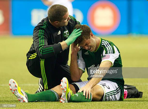 David Horst of the Portland Timbers is aided by athletic trainer Nik Wald during their MLS game against the Vancouver Whitecaps FC October 21 2012 at...