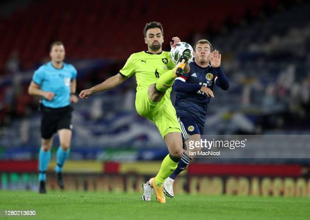 David Hovorka of Czech Republic battles for possession with Ryan Fraser of Scotland during the UEFA Nations League group stage match between Scotland...