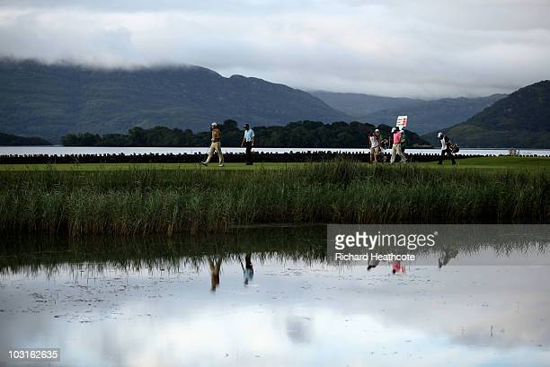 David Howell of England Anders Hansen of Denmark and Francois Delamontagne of France walk off the 1st tee during the second round of the 3 Irish Open...