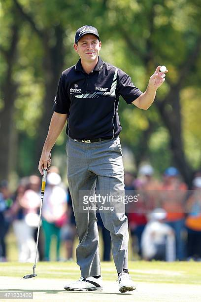 David Howell of England celebrates after chipping in for an eagle during the day four of the Volvo China Open at Tomson Shanghai Pudong Golf Club on...