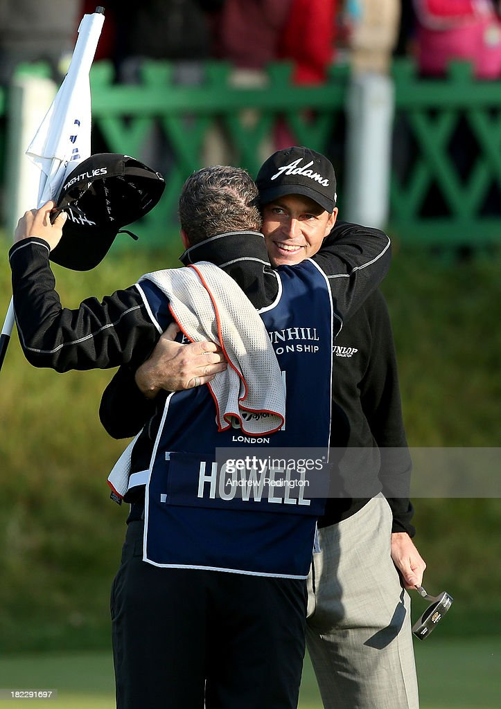 David Howell of England celebrates with his caddy after holing his putt on the 18th green during the second playoff hole against Peter Uihlein of the USA during the final round of the Alfred Dunhill Links Championship on The Old Course, at St Andrews on September 29, 2013 in St Andrews, Scotland.