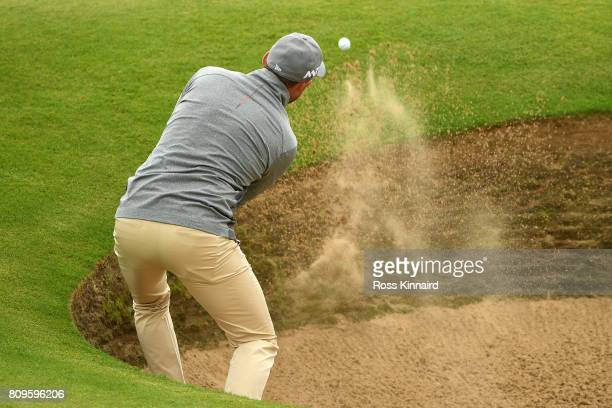 David Howell of England hits from a bunker on the 12th hole during day one of the Dubai Duty Free Irish Open at Portstewart Golf Club on July 6 2017...