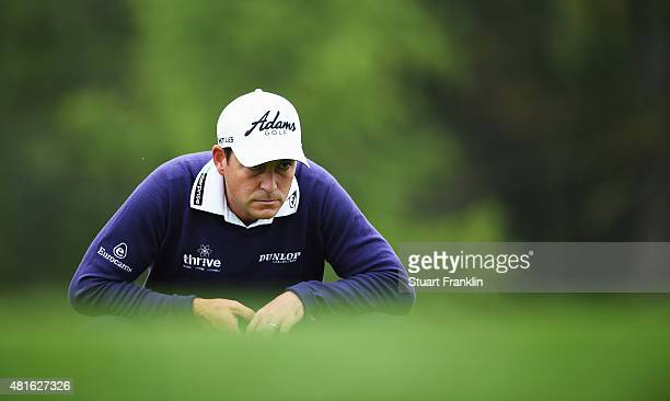 David Howell of England lines up a putt during the first round of the Omega European Masters at CranssurSierre Golf Club on July 23 2015 in...