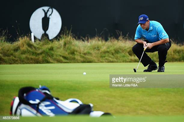 David Howell of England lines up his putt on the third green during the third round of The 143rd Open Championship at Royal Liverpool on July 19 2014...