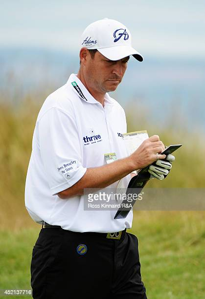 David Howell of England looks at his yardage book during a practice round prior to the start of the 143rd Open Championship at Royal Liverpool on...