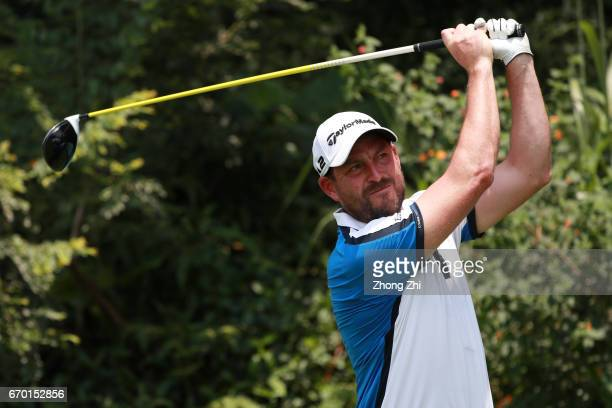 David Howell of England plays a shot during the proam prior to the start of the Shenzhen International at Genzon Golf Club on April 19 2017 in...