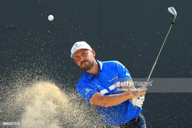 David Howell of England plays his fourth shot from a bunker on the 18th hole during day three of the Italian Open on June 2 2018 in Brescia Italy