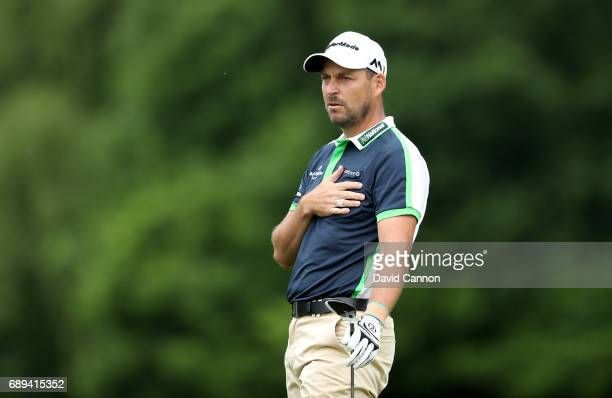 David Howell of England plays his second shot at the par 5 18th hole during the final round of the 2017 BMW PGA Championship on the West Course at...