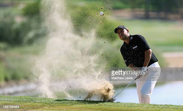 David Howell of England plays out of a bunker on the 7th hole during day four of the Abu Dhabi HSBC Golf Championship at Abu Dhabi Golf Club on...