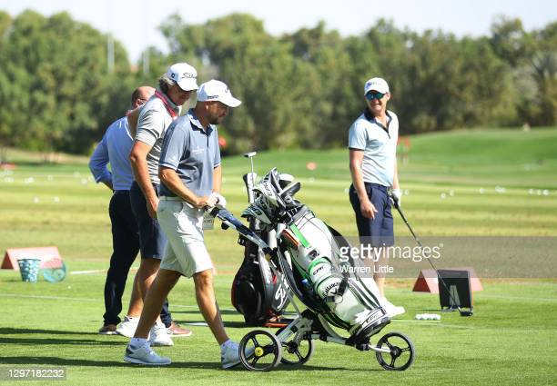 David Howell of England pushes his trolley on the driving range during practice ahead of the Abu Dhabi HSBC Championship at Abu Dhabi Golf Club on...