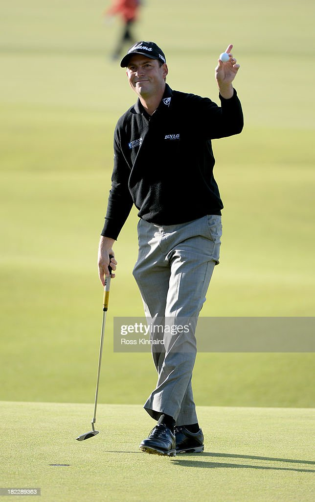 David Howell of England reacts after holing out on the 18th green during the final round of the Alfred Dunhill Links Championship on The Old Course, at St Andrews on September 29, 2013 in St Andrews, Scotland.