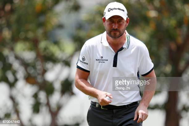 David Howell of England reacts after playing a shot during the proam prior to the start of the Shenzhen International at Genzon Golf Club on April 19...