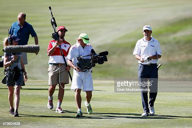 David Howell of England walks on the 18th fairway followed by a TV camera during Day 3 of the Open de Espana held at Real Club de Golf el Prat on May...