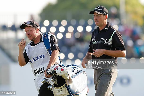 David Howell of England walks with his caddie during the day four of the Volvo China Open at Tomson Shanghai Pudong Golf Club on April 26 2015 in...