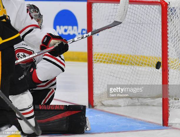 David Hrenak of the St Cloud State Huskies looks on as a puck flies past the goal post during an NCAA Division I Men's Ice Hockey West Regional...