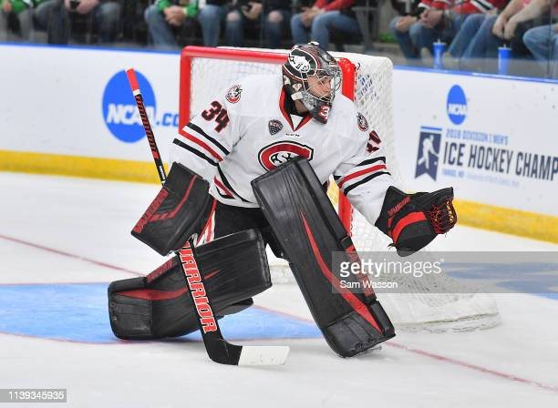 David Hrenak of the St Cloud State Huskies tends goal during his team's NCAA Division I Men's Ice Hockey West Regional Championship Semifinal game...