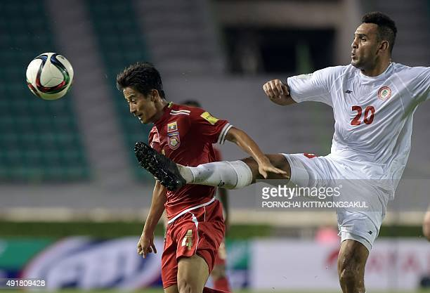David Htan of Myanmar vies for the ball with Roda Antar of Lebanon during the 2018 World Cup qualifying Group G football match between Myanmar and...