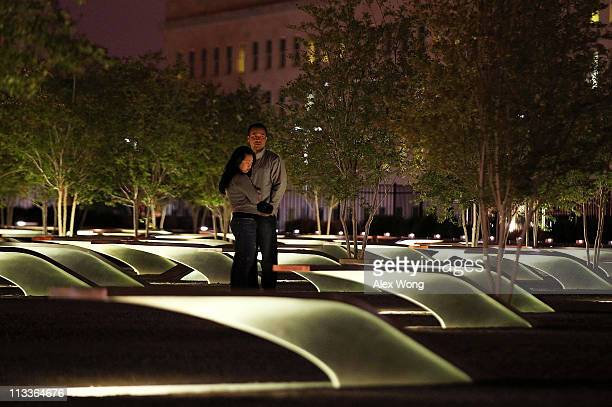 David Huber and Nicole Lozare of Arlington, Virginia, pay their respect to victims of the 9/11 terrorist attacks in the early morning of May 2 after...