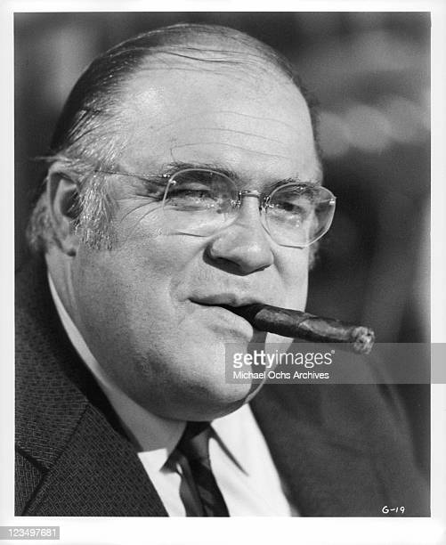 David Huddleston poses with cigar in mouth in a scene from the film 'The Greatest' 1977