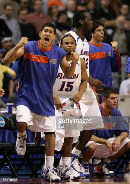 David Huertas and Walter Hodge of the Florida Gators celebrate during the final minute of their 57-53 win against the Georgetown Hoyas during their...