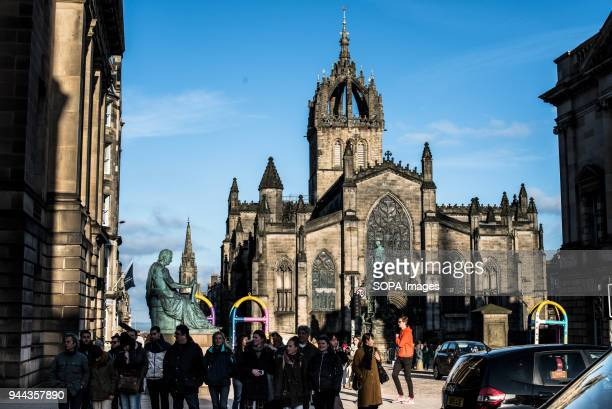 David Hume Statue and St. Giles Cathedral in background. Edinburgh is a city with a population of 500,000 in 2017, it the capital city of Scotland....