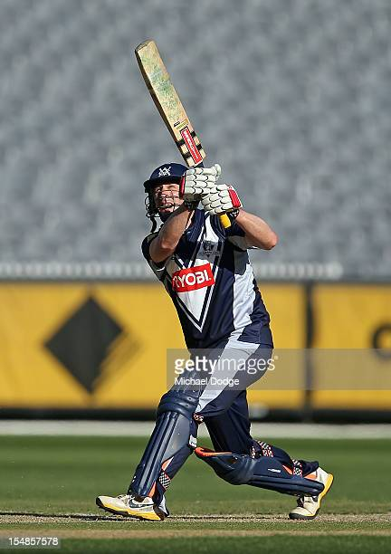 David Hussey bats and hits a six on his way to a century during the Ryobi One Day Cup match between Victorian Bushrangers and the Tasmanian Tigers at...