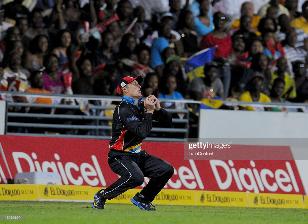 David Hussey of Antigua Hawksbills catching Kieron Pollard of Barbados Tridents during a match between Barbados Tridents and Antigua Hawksbills as part of the week 3 of Caribbean Premier League 2014 at Kensington Oval on July 25, 2014 in Bridgetown, Barbados.